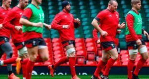 Wales' captain Alun Wyn Jones (centre) participates with team-mates in the captain's run training session at the Principality stadium in Cardiff before the Welsh Rugby Union called off tomorrow's Six Nations game against Scotland. Photograph: Geoff Caddick/AFP via Getty Images)