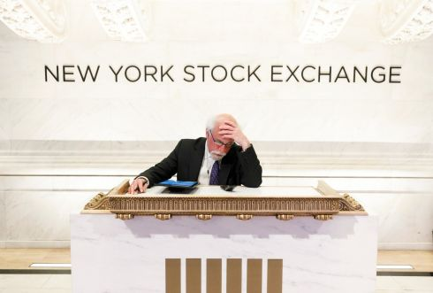 Trader Peter Tuchman works at a podium normally reserved for guests at the opening bell at the New York Stock Exchange in New York, US. Stocks opened sharply lower this morning as investors continue to react to the impact of the coronavirus pandemic. Photograph: Justin Lane/EPA