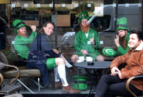 Visitors sit in a coffee shop on St Stephens Green on the Eve of St Patrick's Day in Dublin. Photograph: Dara Mac Dónaill