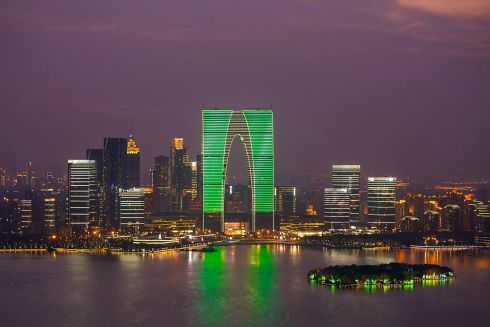 The Gate of the Orient, the tallest building in Suzhou, Jiangsu is seen during Tourism Ireland's annual Global Greening initiative, to celebrate the island of Ireland and St Patrick, in Suzhou, China.