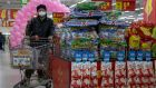 A shopper    in a supermarket in Beijing. China's consumer spending and factory activity fell more than expected in January and February as it fought to stem the pandemic. Photograph: Ng Han Guan/AP