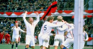 Actor Michael Caine and England player Bobby Moore of the POW XI celebrate during a match against Germany for the film Escape to Victory. Photograph:  Allsport UK /Allsport
