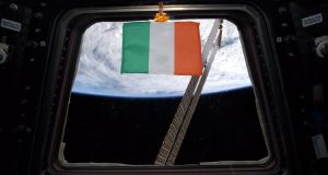 The Irish tricolour floats in a window of the Cupola observatory from where astronauts can observe the Earth.