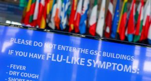 A coronavirus  warning notice  at the European Council, in Brussels, Belgium. Photograph: Stephanie Lecocq/EPA