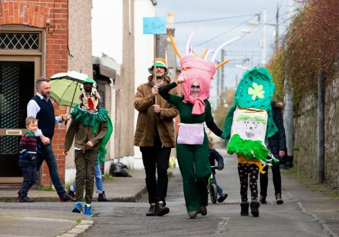 Elaine and Des Smyth with their children enjoying their own mini St Patrick's Day parade in Ballybough, Dublin. Photograph: Tom Honan