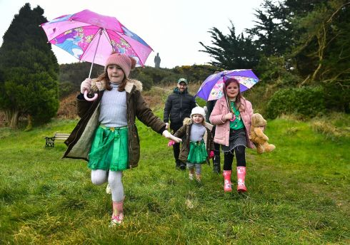 Amelia, Rosa, Farrah, Vincent and Chris Perry brave the weather to celebrate St Patrick's Day at the Slieve Patrick statue in Saul, outside Downpatrick, Co Down. The statue was erected for the 1,500th anniversary of St Patrick's landing at Saul. Photograph Arthur Allison/Pacemaker Press