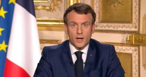 French president Emmanuel Macron gives a TV address to the nation announcing sweeping new measures to stem the spread of the new Covid-19 virus. Photograph: France Televisions via AP