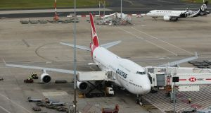 A Qantas Airways aircraft is docked at Sydney Airport in Sydney, Australia. Qantas is cutting almost all overseas flights and more than half its domestic schedule as the coronavirus outbreak paralyses travel worldwide. Photograph: Brendon Thorne/Bloomberg