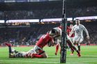 Wales' George North tackled by Manu Tuilagi of England which led to the England player being sent off. Photo: James Crombie /Inpho