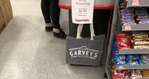 Social distancing measures in place  at checkouts in a SuperValu supermarket in Dingle, Co Kerry. Photograph: PA
