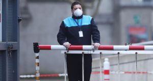 A security guard wearing a face mask at Croke Park in Dublin,  where the stadium is being used as a testing facility for Covid-19. Photograph: Niall Carson/PA Wire