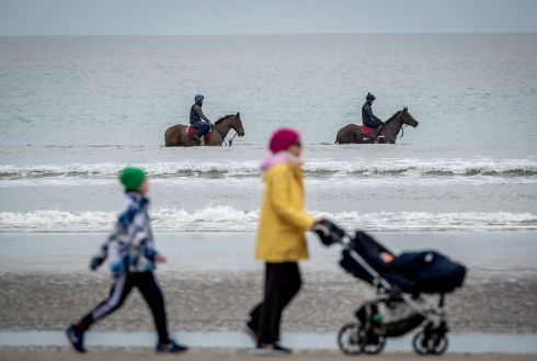 TAKE A DIP: Trainer Garvan Donnelly's horses, Misty Millie with Ben O'Brien and Queen of Soul with Cody Keogh on board, take a walk in the water on the beach at Mornington, Co Meath. Photograph: Morgan Treacy/Inpho