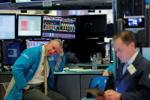 TOUGH TIMES: Traders wait after trading was halted on the floor of the New York Stock Exchange. Photograph: Lucas Jackson/Reuters