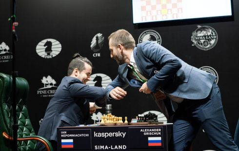 CHECK: Russian chess players Alexander Grischuk and Ian Nepomniachtchi greet each other with an elbow bump instead of a traditional handshake during the Candidates Tournament, organised by the International Chess Federation in Yekaterinburg, Russia. Photograph: Maria Emelianova/FIDE/Handout via Reuters