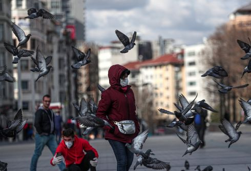TURKEY: People walk with mask at the Taksim Square in Istanbul, Turkey. Health minister Fahrettin Koca said on Tuesday there were 98 confirmed cases of the coronavirus and one related death in the country. Photograph: Sedat Suna/EPA