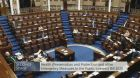 TDs sit two metres apart at an emergency Dáil sitting  as new legislation is passed in response to the spread of Covid-19. Image: Oireachtas TV.