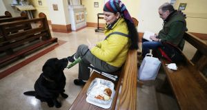 Visually impaired Rosemary Fearsaor-Hughes and assistance dog Quilla in the Capuchin Friary Church on Church Street in Dublin. Photograph: Nick Bradshaw