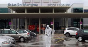 Members of Spain's army emergency unit  disinfect the port of Algeciras in southern Spain, on Thursday. 19 March 2020. Spanish faces its fifth day of lockdown to contain the spreading of coronavirus outbreak. EPA/A.Carrasco Ragel