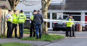 Gardaí at the scene of an incident in which a man was killed by a recycling truck on a housing estate in Oldbawn, Tallaght on Thursday. Photograph: Damien Storan.