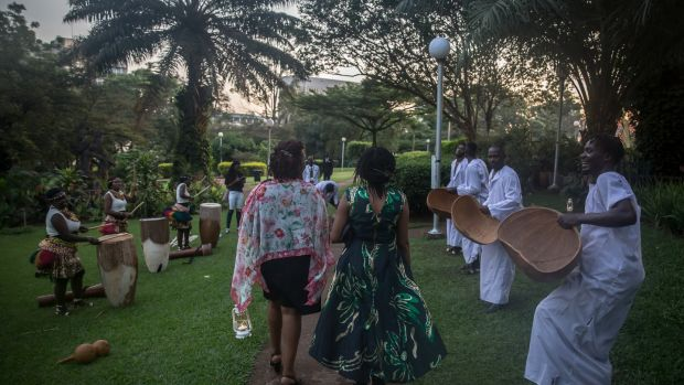 Guests are greeted by local musicians as they arrive at the St Patrick's Day gala ball in the Sheraton Hotel in Kampala. Photograph: Sally Hayden