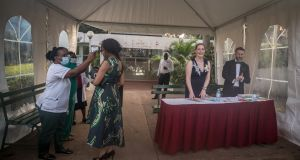 Temperatures are checked as people arrive at the St Patrick's Day gala ball in the Sheraton Hotel in Kampala. Photograph: Sally Hayden