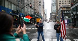 Dermot Hickey and Phillip Vega get their picture taken on a near-empty  Fifth Avenue: Joe Biden is reaching out to the Irish-American community. Photograph: John Minchillo