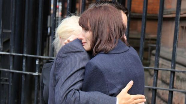 Karen Robinson Walton is comforted after speaking to the media following the inquest into the death of her son Benjamin. Photograph: Paul Faith/PA Wire