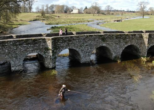 FISHING AT A DISTANCE: Gerard McLoughlin from Kells, Co Meath, practices social distancing while fly-fishing in the Blackwater river on the outskirts of the village. Photograph: Alan Betson