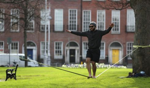 ON THE ROPES: Bruno Diniz practicing slack lining between the trees in Dublin's Mountjoy Square.  Photograph: Nick Bradshaw