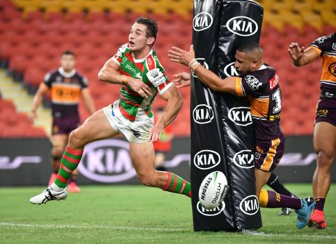 POST GAME: Cameron Murray (left) of the Rabbitohs runs past the ball as Jamil Hopoate of the Broncos collides with the post during the Australian National Rugby League match between the Brisbane Broncos and South Sydney Rabbitohs at Suncorp Stadium in Brisbane, Australia. Photograph: Darren England/EPA