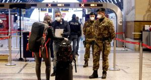 Police and military checks at central station during the coronavirus emergency lockdown, in Milan, Italy. Photograph: EPA