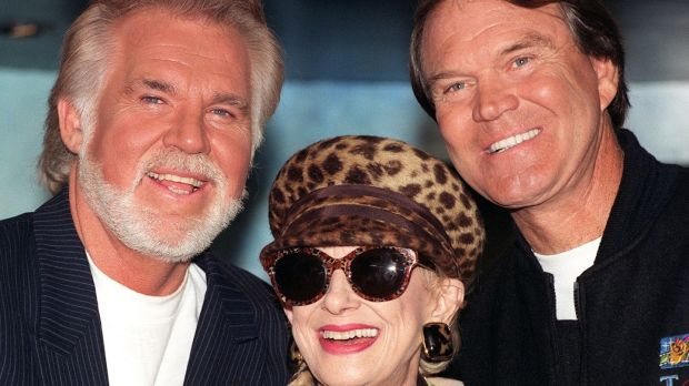 Veteran Country and Western singers (L-R) Kenny Rogers, Tammy Wynette and Glen Campbell in central London in 1996 for a news cinference to launch their Unforgettable tour around Britain. Photograph: Rebecca Naden/PA.