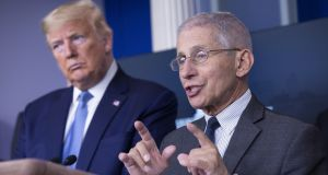 US president Donald Trump and Dr Anthony Fauci, director of the National Institute of Allergy and Infectious Diseases, during a Coronavirus Task Force news conference at the White House on Saturday.  Photograph: Stefani Reynolds/CNP/Bloomberg