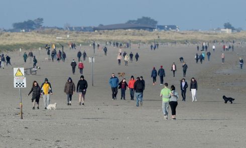 COUPLING UP: Sunday turns out to be a busy Day on Dollymount Strand, Bull Island, Dublin, with many people observing social distancing due to the coronavirus outbreak. Photograph: Alan Betson