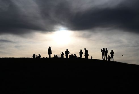 OUT AND ABOUT: People relax on Primrose Hill in London, after the British prime minister Boris Johnson urged UK citizens to practise social distancing, to avoid unnecessary social contacts and to work from home where possible. Photograph: Neil Hall/EPA