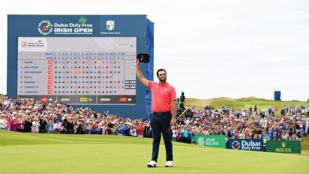 Spain's Jon Rahm waves to the crowd after his putt on the 18th hole on the final day of the Dubai Duty Free Irish Open at Lahinch Golf Club in July 2019. Photograph: Ross Kinnaird/Getty Images