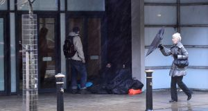 A rough sleeper in Belfast city centre. Photograph: Arthur Allison/Pacemaker