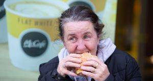 Karen Flood from Ballybough, Dublin enjoys a Burger from McDonald' s on O'Connell Street, Dublin on Monday. Photograph: Tom Honan / The Irish Times