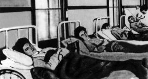 Mary Mallon (First from left) in a hospital bed. She was forcibly quarantined as a carrier of typhoid fever in 1907 for three years and then again from 1915 until her death in 1938. Photograph: Wikimedia Commons
