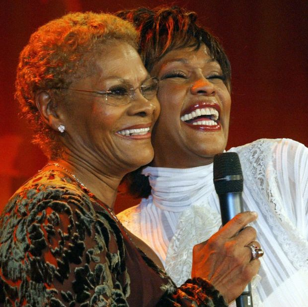 Dionne Warwick with her cousin Whitney Houston in 2004. Photograph: Jochen Luebke/DDP/AFP via Getty