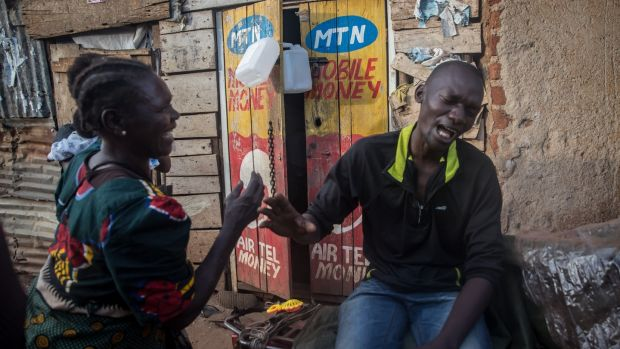 Alan Kiseka (30) tells a fellow Namuwongo resident to stay away from him because of the risk of passing on coronavirus. Photograph: Sally Hayden