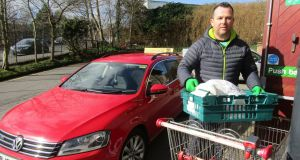 Mark McCleary of Glassagh Taxis delivering from  Ráth Mór Centre in Creggan, Derry