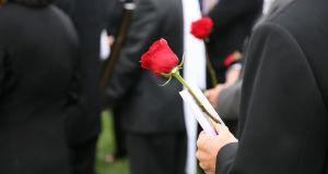 We wanted to offer the grieving family condolences with handshakes and hugs, but we obeyed the rules. Photograph: iStock