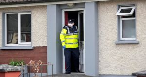 A Garda at the house on Blackthorn Close, Kells, Co Meath, where two men, one from Navan, and one from Kells died in a house fire this  morning. Photograph: Colin Keegan/Collins
