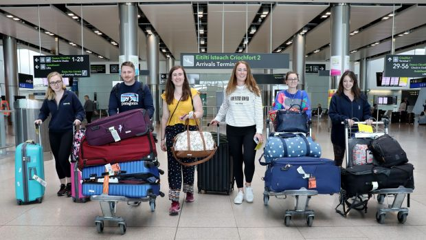 Doctors Aoife Page, Luke Hughes, Rachel Kearns, Hilary Coyle, Deirdre Ryan and Eva Tallon arrive back in Dublin Airport from Perth, Australia to help with the Covid-19 healthcare effort. Photograph: Crispin Rodwell for The Irish Times