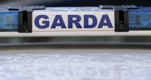 Six men were arrested after a car collided with two Garda vehicles in Finglas, Dublin on Thursday night.