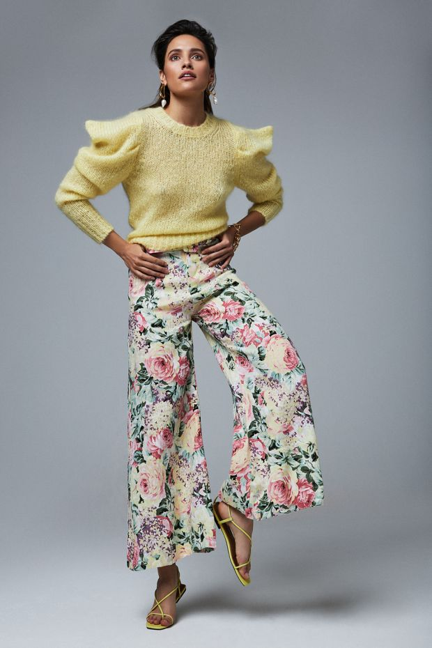 How to wear colour: Yellow knit € 550 Isabel Marant, floral linen trousers € 230 Faithful the Brand, pearl drop earrings € 485 Alighieri, chain bracelet € 95 Kenneth Jay Lane, yellow strappy sandals € 105 Who What Wear