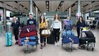 Doctors Aoife Page, Luke Hughes, Rachel Kearns, Hilary Coyle, Deirdre Ryan and Eva Tallon arrive back in Dublin Airport from Perth, Australia on Thursday. Photograph: Crispin Rodwell/ The Irish Times