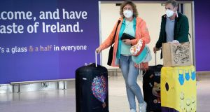 Passengers wearing face masks arrive at Dublin Airport. Photograph:  Colin Keegan/Collins