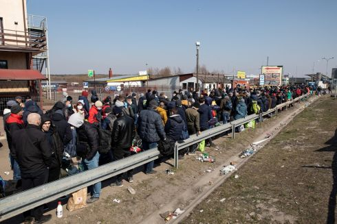 CLOSING BORDERS: People queue to cross into Ukraine at the border crossing in Dorohusk, Poland. Polish authorities plan to close the border to prevent the spread of coronavirus. Photograph: Jakub Orzechowski/Agencja Gazeta via Reuters